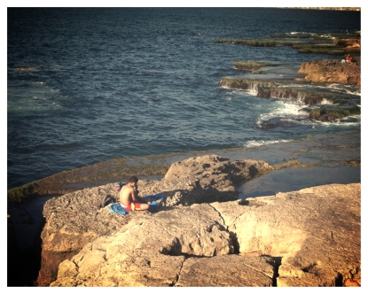 Boy chillin on bey-rock
